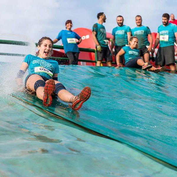 bigstock-Athletes-Sliding-To-Mud-And-Wa-205376923